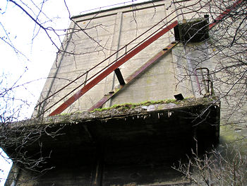 Broken exterior ladder, silo building