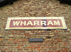 Old station sign for Wharram
